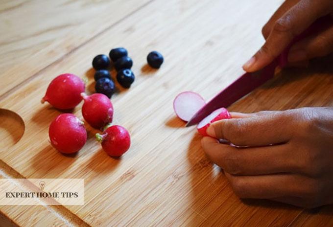 Chopping radish using a knife