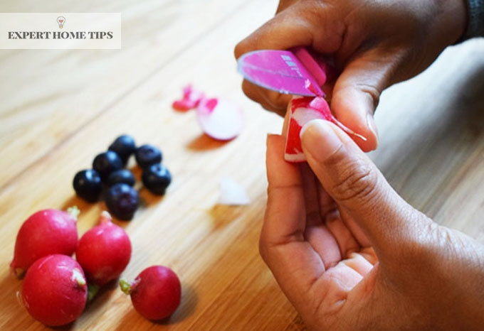 Slicing radish peel with a small knife