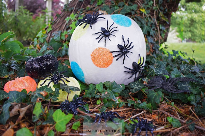 glittery spider decorated pumpkin