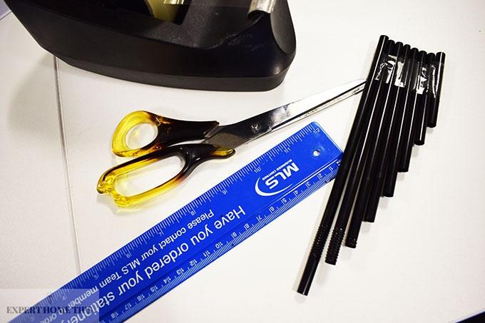 Scissors, ruler, straw pan pipe