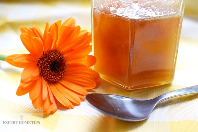 jar of honey and flower