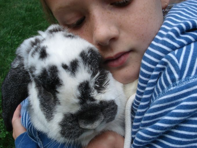 girl with pet bunny